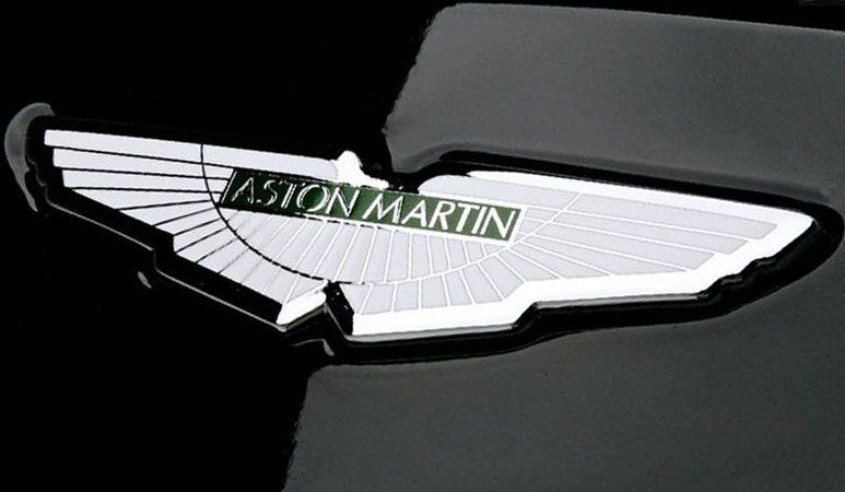 aston martin silver and green emblem on black vehicle - ship enclosed transport