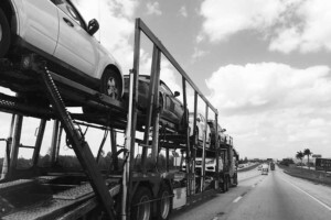 national express car carrier in black and white