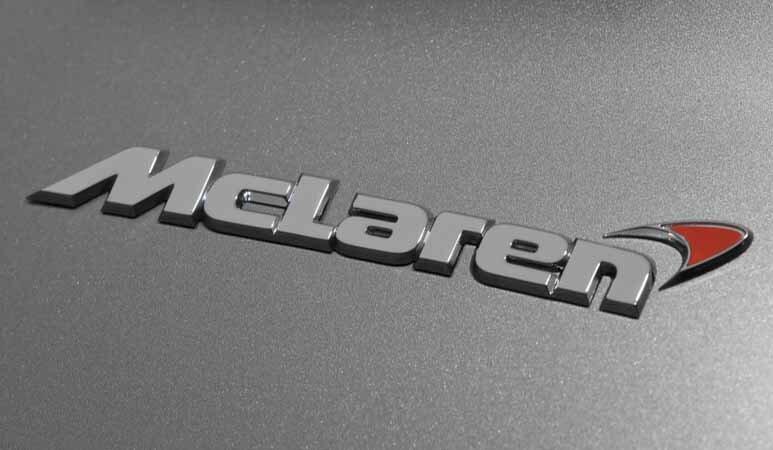 mclaren logo on a car - exotic car shipping enclosed