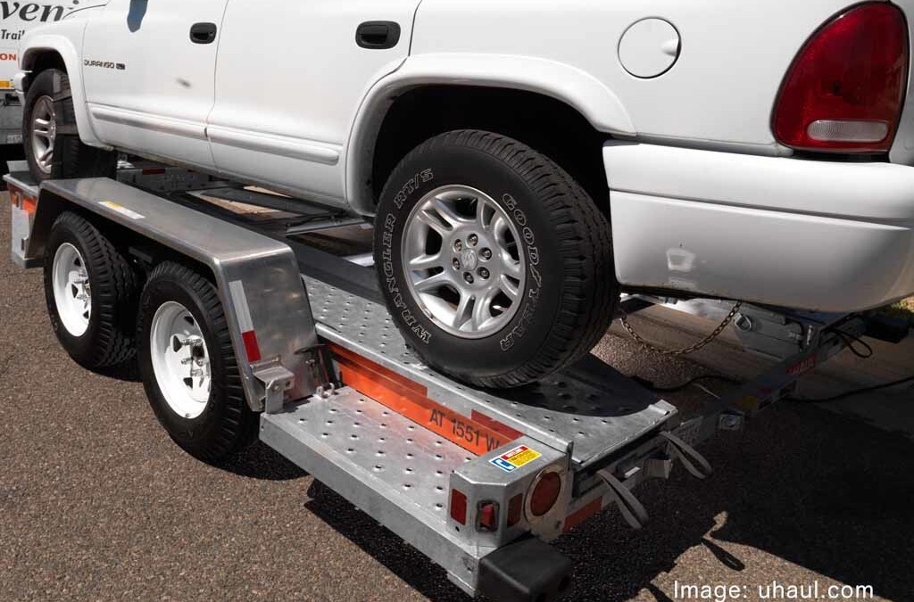 uhaul trailer with suv on top