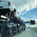 auto transport carrier on highway for delivery
