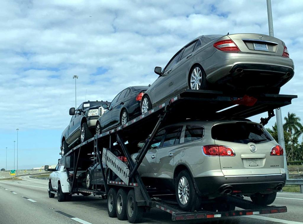 six car carrier pulled by a dually
